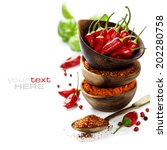 Small photo of Red Hot Chili Peppers with herbs and spices over white background - cooking or spicy food concept