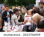 Small photo of Moscow, Russia, August 14, 2016: A man at a street market in a summer park sells Indian goods . Agiotage on a street market .