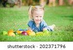 girl eaten colorful fruits... | Shutterstock . vector #202371796