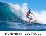 surfing a wave. lombok island.... | Shutterstock . vector #202450780
