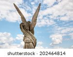 Angel Statue With Blue Sky...