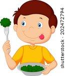 cute little boy eats vegetable... | Shutterstock . vector #202472794