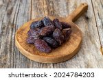 Date Fruit On Wood Background....