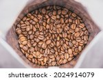 coffee beans in an opened bag ...   Shutterstock . vector #2024914079