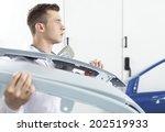 young man holding car door. man ... | Shutterstock . vector #202519933