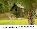 Wooden Green Birdhouse Is...