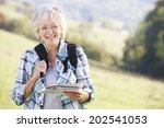 senior woman on country walk | Shutterstock . vector #202541053