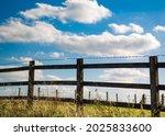 Wooden Fence Alongside An...