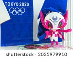 Small photo of tokyo, japan - august 15 2021: Plastic figurine of the official mascot character Someity adorned with the Tokyo 2020 Paralympic Games logo and towels with the five-ringed emblem of the Olympic Games.