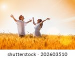happy  young couple with arms... | Shutterstock . vector #202603510