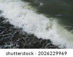 The Sea Wave Foams Near The...