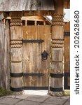 old wooden door on metal hinges | Shutterstock . vector #202628680