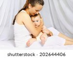 mom and baby bedtime | Shutterstock . vector #202644406