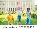 Group Of Kids Throwing Colorful ...