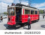 Small photo of ISTANBUL - APRIL 28, 2014: Unknown people with traditional red tram trundled along ?stiklal Caddesi for 1.64 km (1 mile) connecting Taksim Square with Galatasaray and t�¼nel Square.