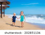 two happy kids playing in a... | Shutterstock . vector #202851136