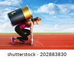 Woman preparing to run with a battery on her back - stock photo