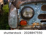 Two Round Headlights Of An Old...