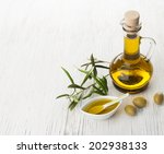 olive oil and olive branch on... | Shutterstock . vector #202938133