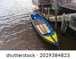 Rowboat Canoe Moored At Dock