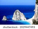 Coastal rock on the seashore. Rock island in blue sea. Sea rock. Beautiful coastal landscape