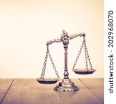 law scales on table. symbol of... | Shutterstock . vector #202968070