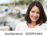beautiful friendly young woman... | Shutterstock . vector #202991464