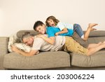 father and son on the sofa... | Shutterstock . vector #203006224