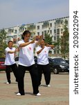 Small photo of LUANNAN COUNTY - JUNE 29: A group of people were performing shadowboxing in the square, on june 29, 2014, LuanNan county, hebei province, China
