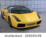 Постер, плакат: Yellow Lamborghini car parked