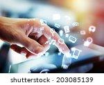 hand touching digital tablet ... | Shutterstock . vector #203085139