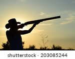 girl with a rifle | Shutterstock . vector #203085244