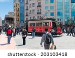 Small photo of ISTANBUL - APRIL 28, 2014: Traditional red tram trundled along Istiklal Caddesi for 1.64 km (1 mile) connecting Taksim Square with Galatasaray and Tunel Square.