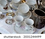 Some Cups Saucers Teapots And...