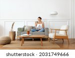 woman relaxing in a minimal home   Shutterstock . vector #2031749666