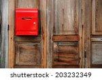 Red Mailbox On The Wooden Door