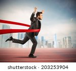 Small photo of Concept of successful businessman in a finishing line