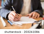architect working at his desk... | Shutterstock . vector #203261086