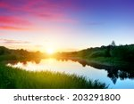 lake in forest at sunset.... | Shutterstock . vector #203291800