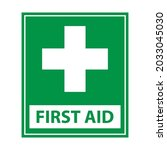 first aid sign and white cross...