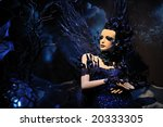High fashion model in blue dress at a fantasy party - stock photo