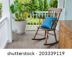 wooden rocking chair on front... | Shutterstock . vector #203339119
