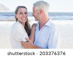 happy couple hugging on the... | Shutterstock . vector #203376376