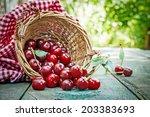 Ripe Cherries In Basket On Old...
