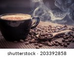 coffee cup and coffee beans | Shutterstock . vector #203392858