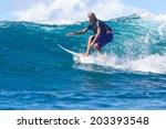 surfing a wave. lombok island.... | Shutterstock . vector #203393548
