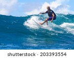surfing a wave. lombok island.... | Shutterstock . vector #203393554