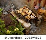 preparing chicken on grill in...   Shutterstock . vector #203394823