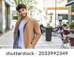Young Hispanic Man Smiling...