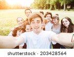 ten friends do a selfie in the... | Shutterstock . vector #203428564